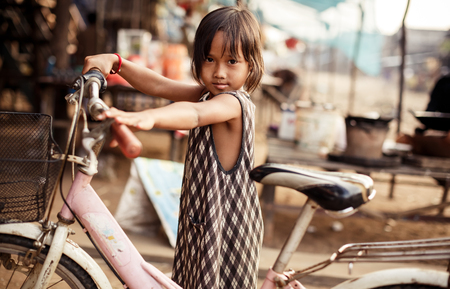 tonle sap: KAMPONG PHLUK,CAMBODIA - JANUARY 01: Portrait of an unidentified Khmer girl on Tonle Sap Lake in Kampong Phluk,Cambodia on 01.2014 January .It is the largest lake in Southeast Asia (up to 16,000 square km).