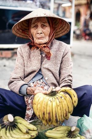 conical hat: Vietnamese street vendor in Hue, Vietnam Editorial