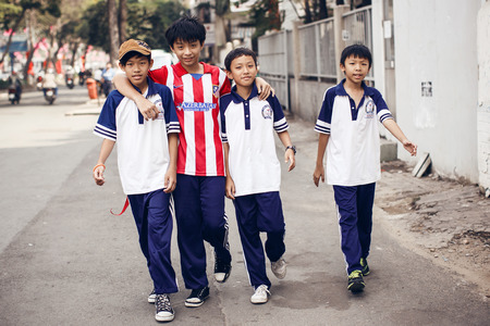regularity: Unidentied boys walking on street in Ho Chi Minh Editorial