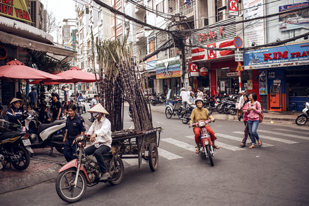 The streets of Saigon are crowded with scooters, motorbikes, bicycles