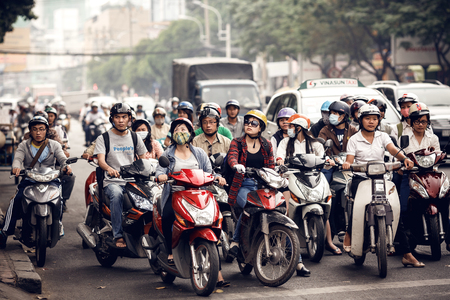The streets of Saigon are crowded with scooters, motorbikes, bicycles Editorial
