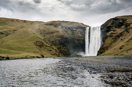 lowlands: Famous Skogafoss waterfall in Iceland at dusk Stock Photo