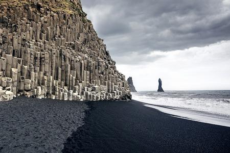 The black sand beach of Reynisfjara in Iceland photo