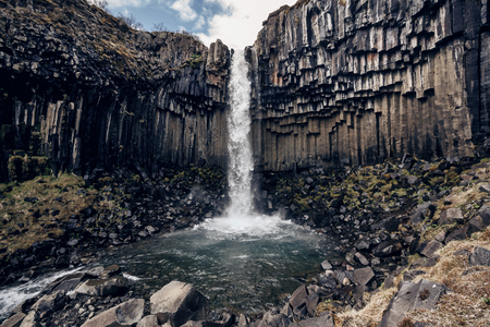 waterfall with sky: Svartifoss, Black Waterfall Stock Photo