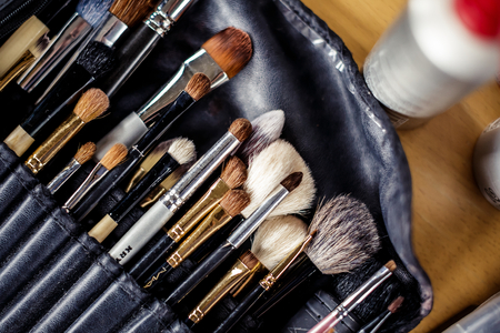 Make up brushes in black leather bag photo