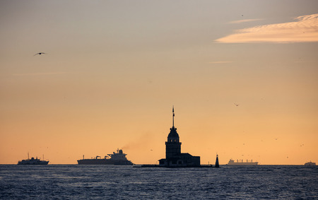 Silhouette of Maidens Tower and ships photo