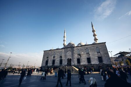 ISTANBUL, TURKEY - NOVEMBER 28: Low angle view of Famous Suleymaniye Mosque and walking people in front in Istanbul against blue sky on November 28, 2014