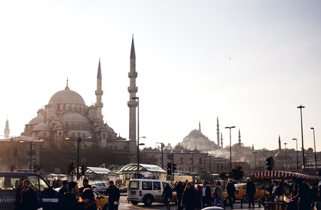 ISTANBUL, TURKEY - NOVEMBER 28: Busy people and city traffic on background of Suleymaniye Mosque, Istanbul, Turkey on November 28, 2014
