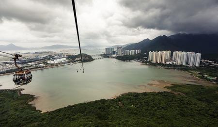 lantau: Cableway in Lantau against cloudy sky