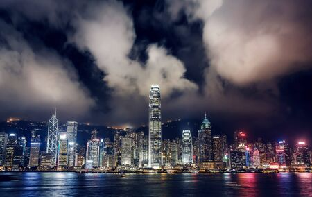 neon lights: Hong Kong Skyscrapers with lights Stock Photo