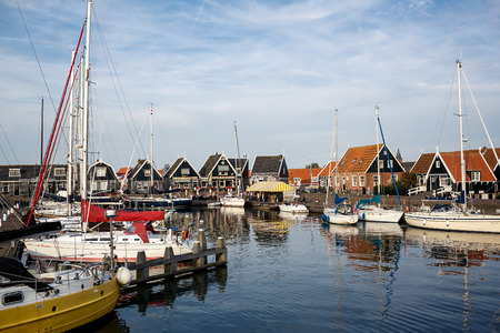 MARKEN ISLAND, NETHERLADS - SEPTEMBER 28, 2014: Traditional houses on the island of Marken, Netherlands Editorial