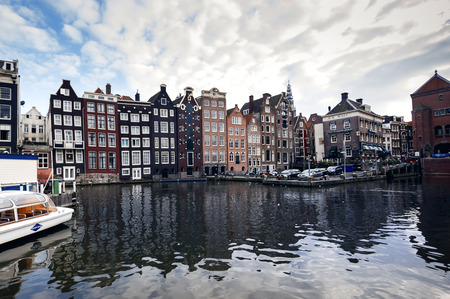 gabled house: AMSTERDAM - SEPTEMBER 27, 2014: Romantic canal, boat. Urban landscape in Amsterdam, Netherlands Editorial