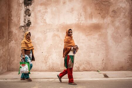 agra: AGRA, INDIA - JANUARY 8, 2015: Two young Indian women on the street on January 8, 2015 in Agra, India Editorial