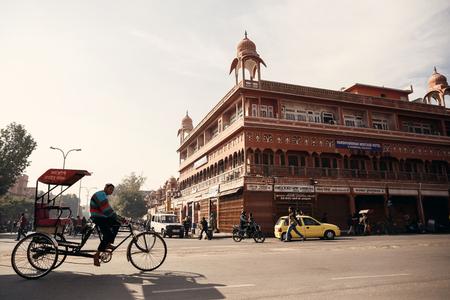 jaipur: JAIPUR, INDIA - JANUARY 10, 2015: Man riding cycle rickshaw on street on January 10, 2015 in Jaipur, India Editorial
