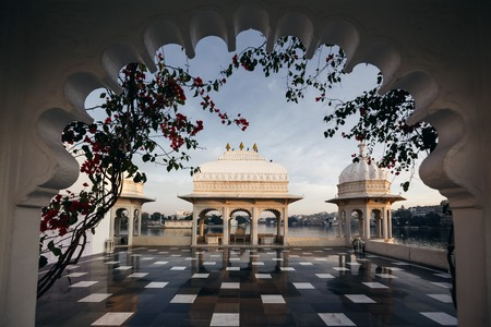 voted: UDAIPUR, INDIA - JANUARY 13, 2015: Taj Lake Palace on January 13, 2015 in Udaipur, India. The Lake Palace was built between 1743 and 1746, it has been voted as the most romantic hotel in India and in the world.
