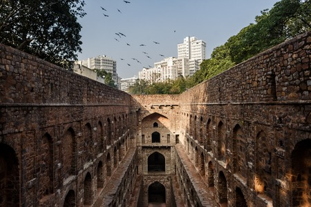 believed: DELHI, INDIA - JANUARY 4, 2015: Agrasen ki Baoli on January 4, 2015 in Delhi, India. Agrasen ki Baoli is a step well and is believed it was built during the Mahabharat epic era and rebuilt in the fourteenth century.