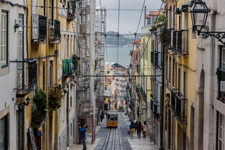 bica: LISSABON, PORTUGAL - OCTOBER 17, 2015: Famous Bica funicular on street of Lissabon. It was constructed by Raoul Mesnier de Ponsard and opened in 1892 Editorial