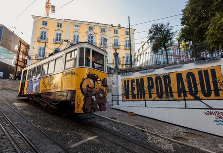 bica: LISSABON, PORTUGAL - OCTOBER 17, 2015: Famous Gloria funicular on street of Lissabon. It was opened in 1885 and in February 2002 was classified as a national monument Editorial