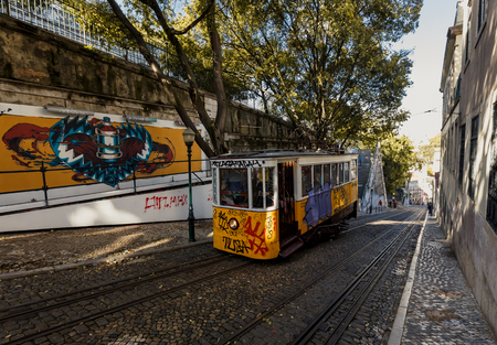 gloria: LISSABON, PORTUGAL - OCTOBER 17, 2015: Famous Gloria funicular on street of Lissabon. It was opened in 1885 and in February 2002 was classified as a national monument Editorial