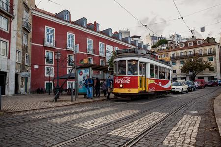 ascensor: LISSABON, PORTUGAL - OCTOBER 17, 2015: Famous old tram on street of Lissabon
