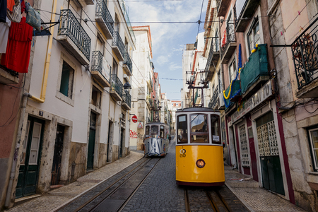 ascensor: LISSABON, PORTUGAL - OCTOBER 18, 2015: Famous Bica funicular on street of Lissabon. It was constructed by Raoul Mesnier de Ponsard and opened in 1892