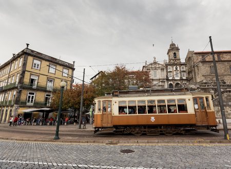 trams: PORTO, PORTUGAL - OCTOBER 19, 2015: Famous old tram on street of Porto. Trams operating in Porto since 1872