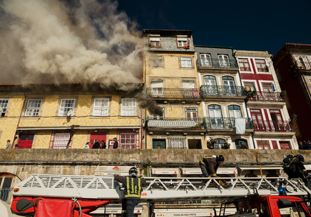 architectural heritage of the world: PORTO, PORTUGAL - OCTOBER 20, 2015: Firemen during their work in historical center of Porto, Portugal Editorial
