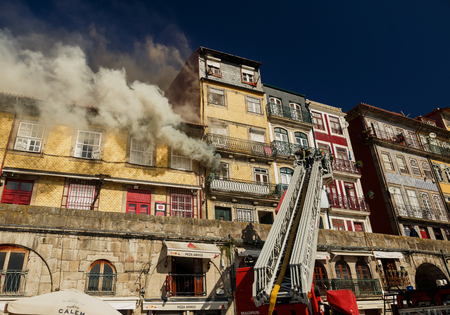 portugal: PORTO, PORTUGAL - OCTOBER 20, 2015: Firemen during their work in historical center of Porto, Portugal Editorial