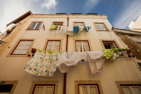 old houses: Washed laundry hanging outside building in Lissabon, Portugal