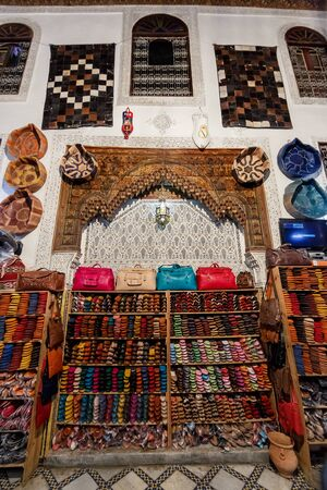 fes: FES, MOROCCO - NOVEMBER 1, 2015: Historical leather factory store in Fes Medina, Morocco