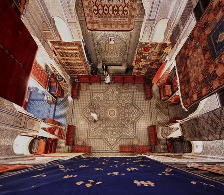 religious building: FES, MOROCCO - NOVEMBER 1, 2015: Historical carpet store in Fes Medina, Morocco Editorial