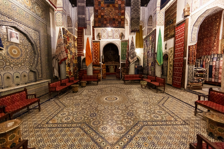 fes: FES, MOROCCO - NOVEMBER 1, 2015: Historical carpet store in Fes Medina, Morocco Editorial