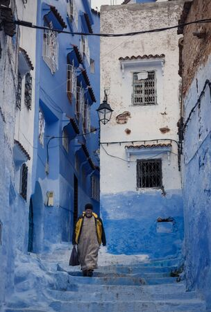 pot light: CHECHAOUEN, MOROCCO - NOVEMBER 2, 2015: One of the streets in Chefchaouen in Morocco. All the houses and walls are painted blue. Popular tourist destination in Morocco.