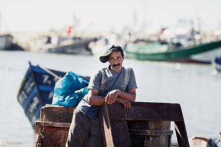 network port: ESSAOUIRA, MOROCCO - NOVEMBER 4, 2015: Unidentified fisherman in the port on the coast of Essouira, Morocco.