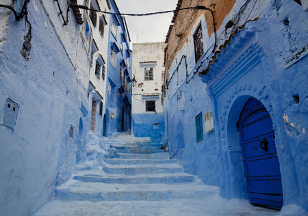 pot light: One of the streets in Chefchaouen in Morocco. All the houses and walls are painted blue. Popular tourist destination in Morocco. Stock Photo