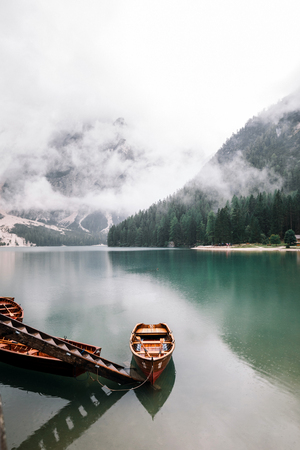 Boats on Lago di Braies in Dolomites, Italy Stock Photo