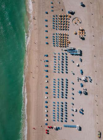 Sandy beach with sun loungers, Miami Beach, Florida, USA