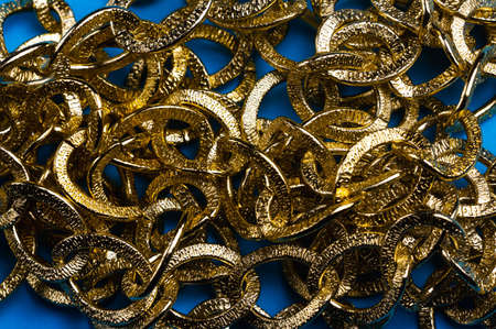 golden chain on a blue background. copy space one