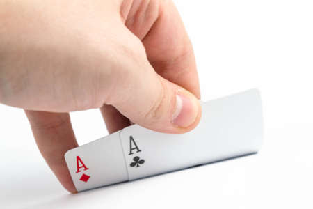 Hand raises two aces, pocket pair on a white background isolate