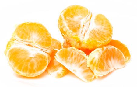 Half tangerine orange cut in half on a white background