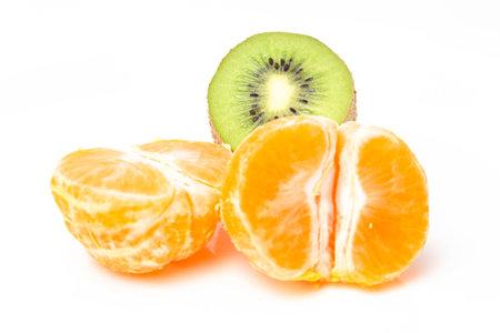 Orange mandarin and green kiwi on a white background