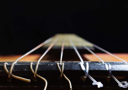 acoustic guitar strings on black background