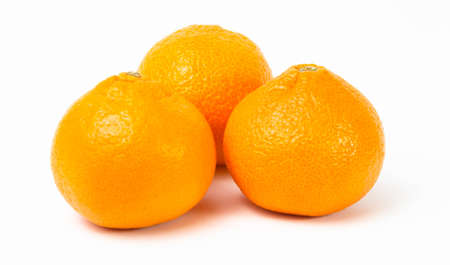 Ripe orange tangerines on a white background Banco de Imagens