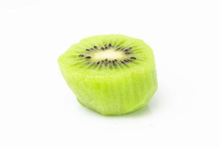 Green kiwi cut in half half on a white background