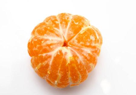 Orange mandarin peeled on a white background