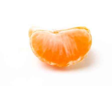 Orange mandarin one slice on a white background Banco de Imagens