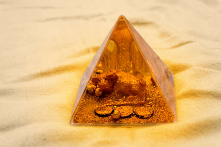 Gold epoxy pyramid with coins and bull
