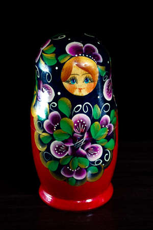 painted nesting doll on a dark background