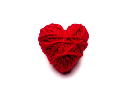 red knitted heart for Valentine's day on a white background, isolate .close up