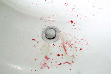 blood in the sink and toothpaste bleed gum copy space. close up